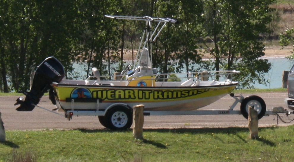 Water skiing towing requirements boating legally for Boat garage on water