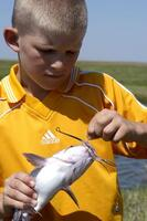 Boy with channel catfish