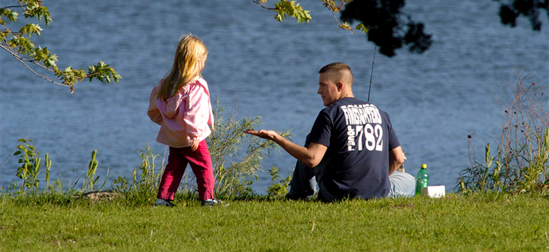 Dad and daughter fishing.