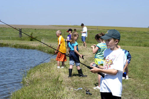 A group of children fishing