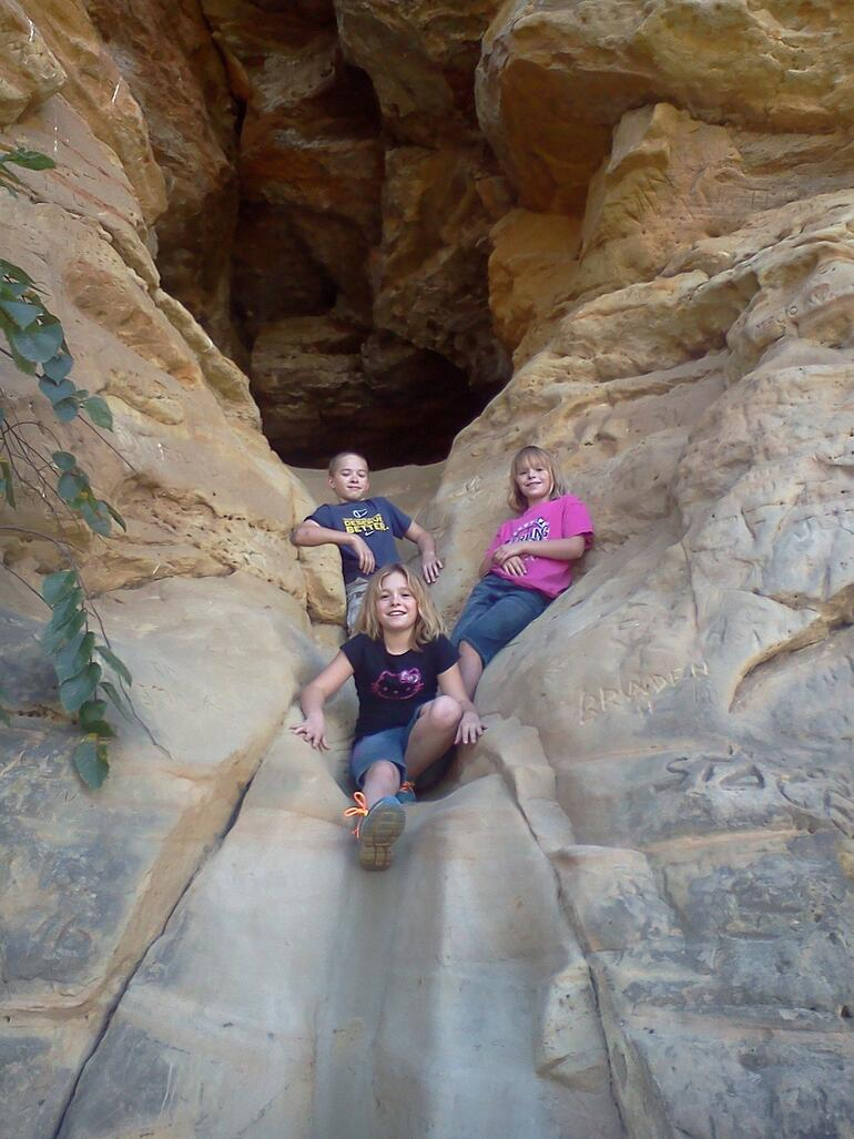 Kids enjoying the Slide Cave on the Buffalo Track Canyon Nature Trail at Kanopolis State Park